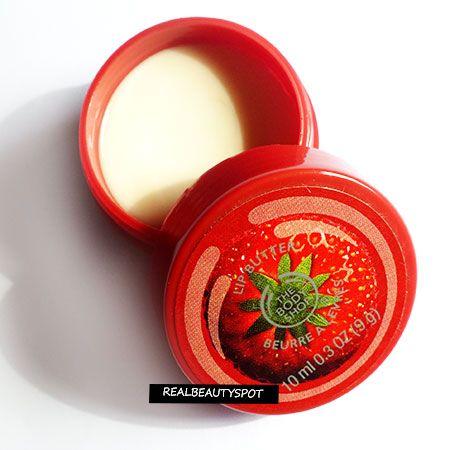 Fotografía - L'examen de beurre pour les lèvres atelier de carrosserie de la fraise