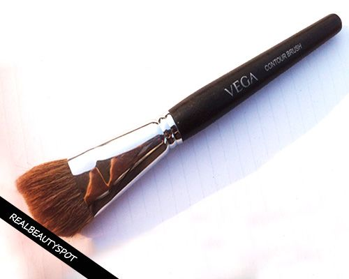 Fotografía - Vega contour professionnelle examen de brosse